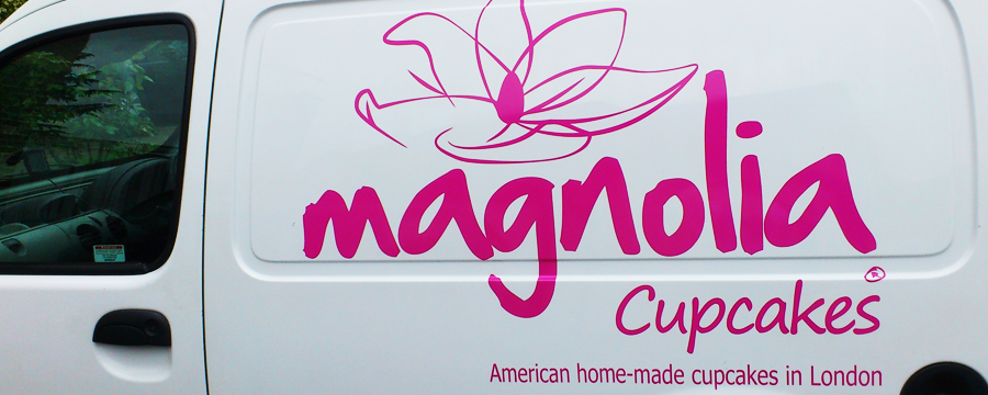 Full-color nylon digital vehicle lettering of Magnolia Cupcakes logo on a van.