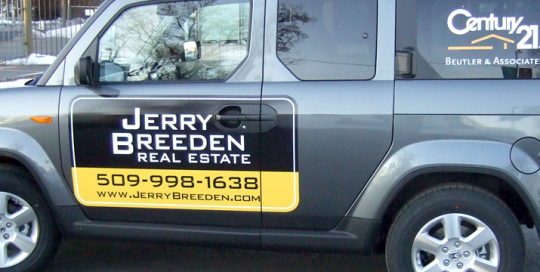 Car with magnet of Real Estate agent