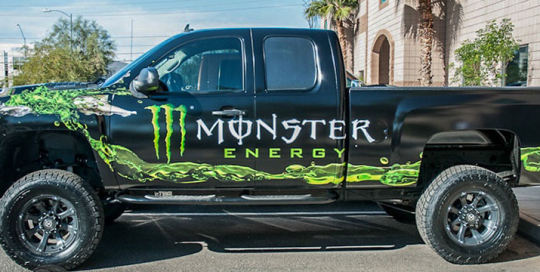 Custom printed vehicle wrap for pickup truck.