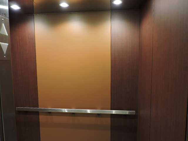 Elevator cab architectural film covering